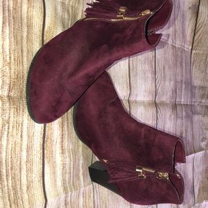 Purple booties with tassel